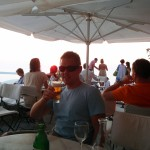 A beer to watch the sun go down in Oia, Santorini