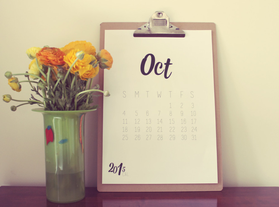 Calendar for October 2015 and flowers in a vase