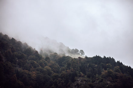 autumn clouds over forested hills
